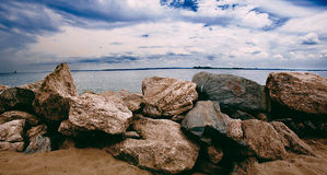 Sandy Rocks In Orchard Beach Image stock