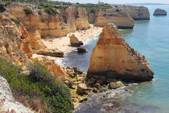 Sandy and rocky beach of Marinha cove Stock Photography