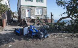 Sandy's Aftermath. NEW YORK - NOVEMBER 12, 2012:Pile of garbage, debris near flooded and damaged house after Hurricane Sandy  on Manhattan Beach on November 12 Stock Photography