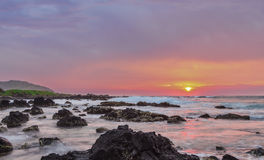 Sandy's Sunrise. Intensely colofrul sunrise over the ocean at Sandy Beach in Oahu, Hawaii Stock Photos