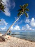 Sandy sea beach and palm tree Royalty Free Stock Photo