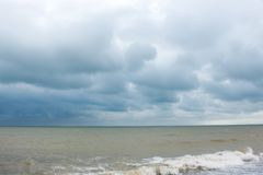Sandy sea beach during strong wind Stock Image