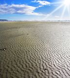 Sandy shallow on a beach Royalty Free Stock Images