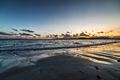 Sandy shore in Alghero at sunset Stock Photo
