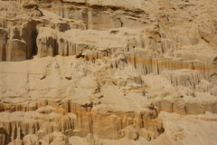 Sandy shore - background and texture. Sandy slope where you can see layers of sediment Royalty Free Stock Photo