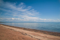 Sandy shore of lake Baikal. royalty free stock photo