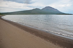 Sandy shore of lake in the Putorana plateau. Royalty Free Stock Photos