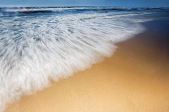 Sandy shoreline with motion in the netherlands Stock Photography