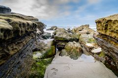 Sandy shoreline of San Diego. Rocky and sandy shoreline of San Diego, California in the early morning Royalty Free Stock Photography