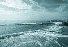 The sandy shores of the Atlantic Ocean. Portugal. Toned Royalty Free Stock Images