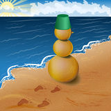 Sandy snowman on the beach Royalty Free Stock Images