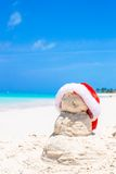 Sandy snowman with red Santa Hat on white Royalty Free Stock Images