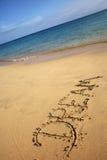 Sandy-Strand mit Traumzeichen Stockbild