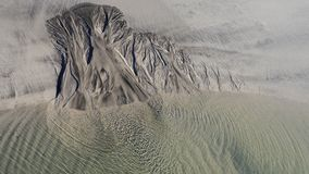 Sandy structure at low tide the sea Royalty Free Stock Photo