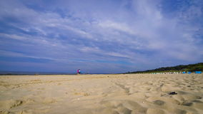 Sandy summer Baltic beach in Swinoujscie, Poland Royalty Free Stock Image