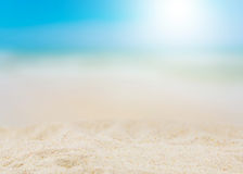 Sandy summer beach with blur sea Royalty Free Stock Images