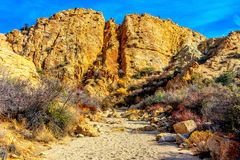 Sandy Trail in the Desert. Sandy Trail under a large desert mountain wall in Joshua Tree Royalty Free Stock Images