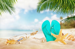 Sandy tropical beach with bottle and starfish Royalty Free Stock Images