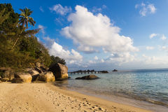 Sandy tropical beach with huge boulders Stock Image