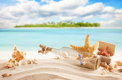 Sandy tropical beach with island on background Stock Images