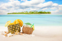 Sandy tropical beach with summer drinks Stock Images