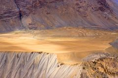 Sandy untouched flat area among the mountains. royalty free stock image