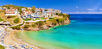 Sandy Varkotopos beach, resort Bali. Crete, Greece. Sandy Varkotopos beach in sea bay of resort village Bali. Views of shore, washed by waves with sun loungers royalty free stock photo
