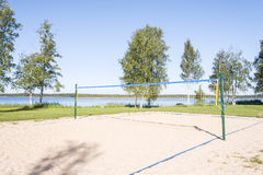 Sandy volleyball field at a lake coast Royalty Free Stock Photography