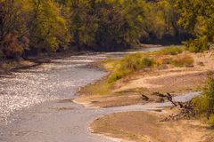 Sandy Banks of the Turkey River. Sandy washed banks of the river after the summer floods Royalty Free Stock Photos