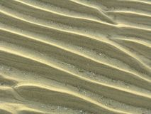 Sandy waves. In the mud flats Stock Photos