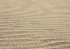 Sandy waves - Horizontal endless sand texture build and created by the wind and ocean Stock Photo