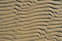 Sandy waves texture Stock Photos