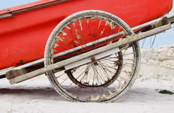 Sandy wheels on a red boat Royalty Free Stock Photos