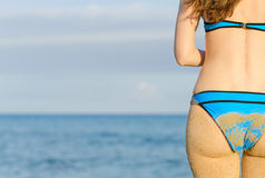 Sandy woman buttocks. Stock Images