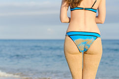 Sandy woman buttocks. Royalty Free Stock Photos