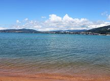Sandy beach, wonderful sea and mountain views. royalty free stock photography