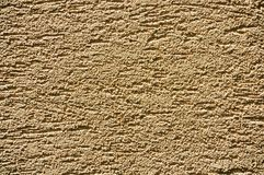 Sandy-yellow stucco texture Royalty Free Stock Image