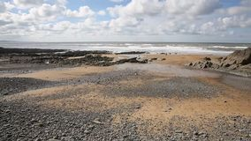 Sandymouth beach North Cornwall England UK on the south west coast path and near Bude stock footage