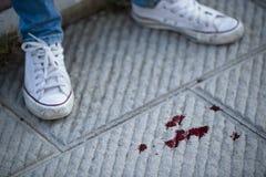 Sang sur le trottoir Image stock
