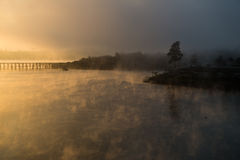Sangkhla Buri. Mist floating on the water.Mon bridge at Vajiralongkorn dam Royalty Free Stock Image