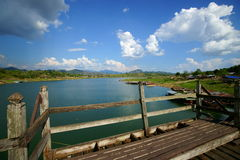 Sangkhlaburi artificial lake from saphan mon. Saphan mon, or mon bridge. 400 m. long, made by hand, wooden bridge that crosses the khao laem artificial lake Stock Photos