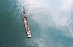 SANGKLABURI, KANCHANABURI THAILAND - March 1, 2017 : Beautiful s. SANGKLABURI, KANCHANABURI THAILAND - March 1, 2017 : A fisherman rides long tail boat across Stock Photography
