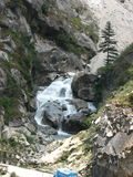 Sangla Valley in Himachal Pradesh. Scenic view of a waterfall on the rocky mountainside of Sangla valley, Himachal Pradesh, India Stock Image