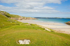 Sango Bay and Eilean Moar Isle, northern Scotland. Quiet beach in front of north sea at Sango Bay looking at Moar isle, Durness, nothern Scotland stock images