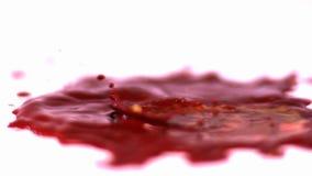 Sangre misteriosa en la cámara lenta almacen de metraje de vídeo