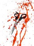 Sangre y tijeras del corte del pelo Foto de archivo libre de regalías