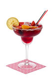 Sangria. Glass of sangria with a slice of lemon, and assorted fresh fruit against a white background royalty free stock photography