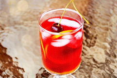 Sangria. With Ice in a glass with orange slices and a cherry on top Stock Photos