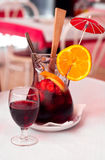 Sangria. Traditional Spanish wine beverage sangria with strawberries, orange and ice on a table in cafe royalty free stock images