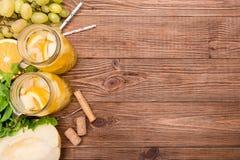 Sangria del vino bianco con il melone e l'arancia Fotografia Stock Libera da Diritti